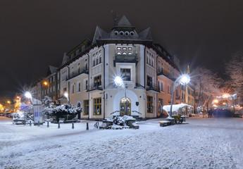 Beautiful house in main street in Zakopane in the snow evening
