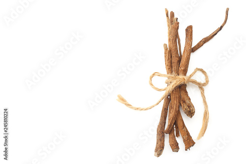 Photo  licorice roots isolated on white background. top view