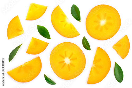 persimmon slice with leaves isolated on white background. Top view. Flat lay pattern