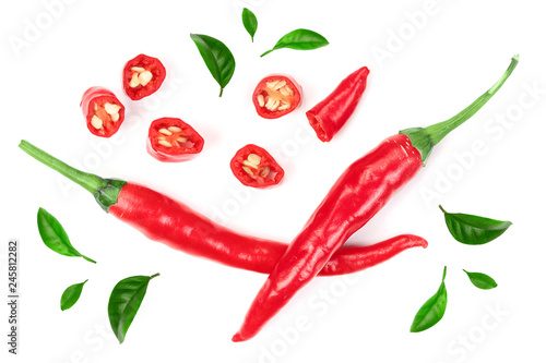 Poster Hot chili Peppers sliced red hot chili pepper decorated with green leaves isolated on white background. Top view. Flat lay pattern