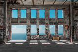 Fototapeta Młodzieżowe - Abandoned  factory ruin  / warehouse loft with windows and ocean and blue sky background