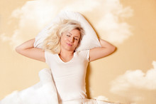 Happy Caucasian Woman Enjoying In Good Sleep, Sleeping In Clouds