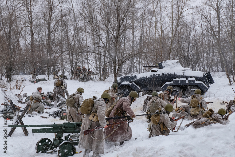 Fototapeta Soviet and German soldiers in winter reconstruction of World War 2, Battle for Voronezh rebellion