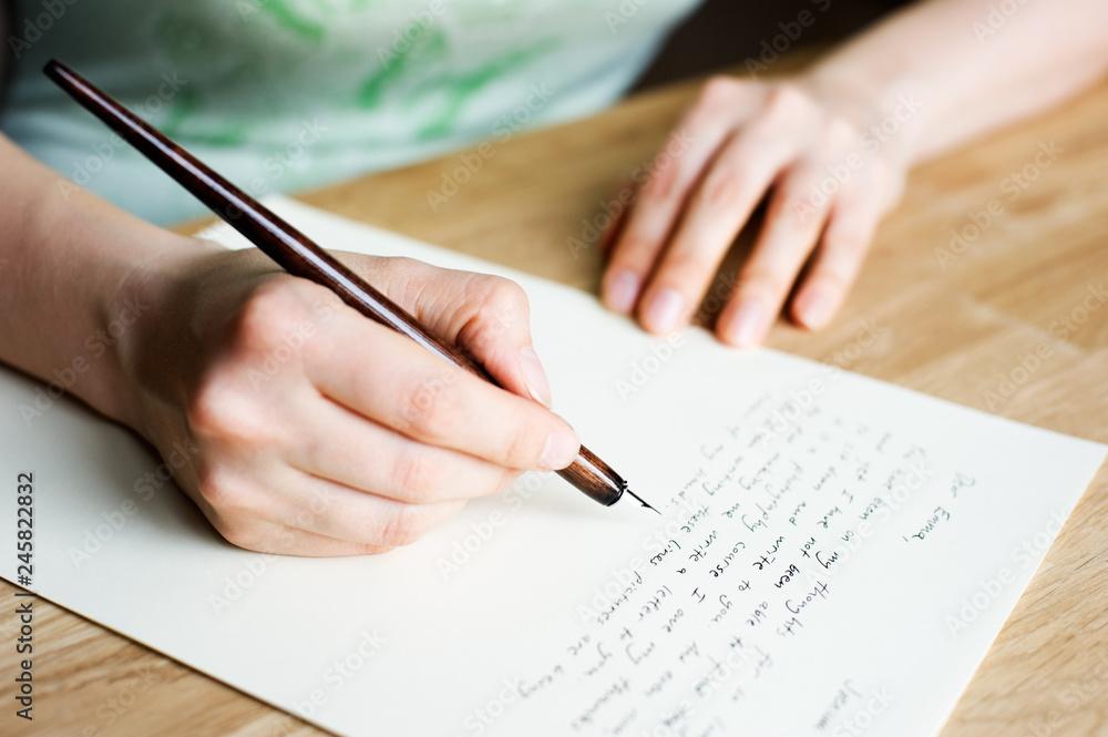 Fototapeta Writing letter to a friend.
