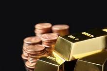 Shiny Gold Bars And Coins On Black Background, Closeup. Space For Text