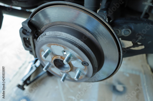 Fotografie, Obraz  Disc brake rotor and pads on a vehicle