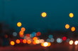 Abstract blurred light in night time of urban with bokeh background.