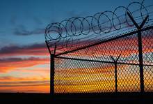 BSilouette Of Fence At Sunset