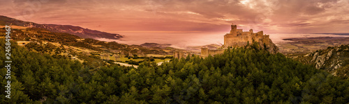 Aerial panorama view of medieval Romanesque partially restored Loarre castle near Huesca in Aragon province Spain surrounded by fog and clouds