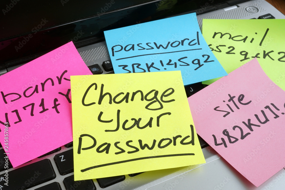 Fototapeta Change your password. Laptop with pieces of paper.