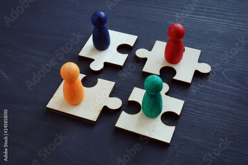 Fototapeta Employee relations and teamwork concept. Pieces of puzzles.