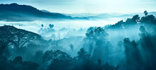 Beautiful Landscape Of Mountains And Rainforest In Early Morning Sun Rays And Fog In Myanmar.