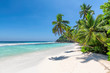 Exotic sandy beach with coco palms and turquoise sea in Jamaica island. Summer vacation and travel concept.