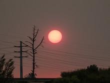 Fiery Sunset Amidst Smoke From...