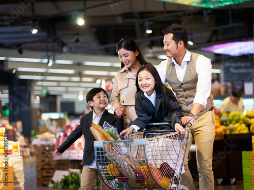 asian family shopping in supermarket