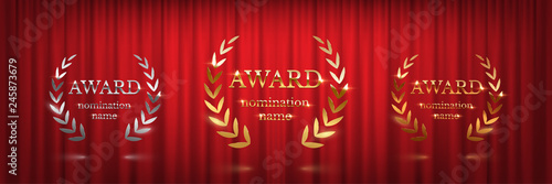 Golden, silver and bronze award signs with laurel wreath isolated on red curtain background Canvas Print