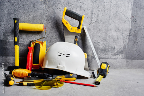 Valokuvatapetti set of construction tools on a black wall background