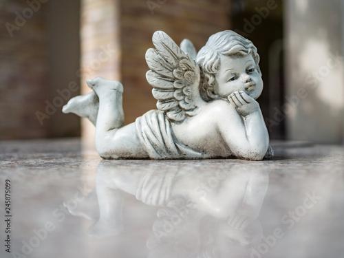 Vintage filter on Cupid sculpture close up Fototapeta