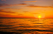 canvas print picture - Beautiful fiery sunset sky on the beach. Composition of nature