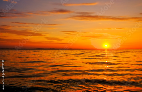 Fototapeta Beautiful fiery sunset sky on the beach. Composition of nature obraz