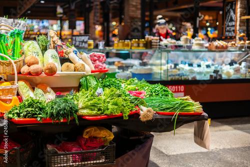Fotografija  fresh vegetables and fruits in vegan food store  b