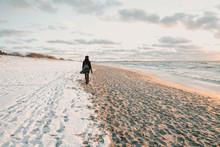 Woman Walking On Snow Coast Ne...
