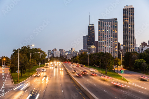 Chicago, traffic on highway with city skyscrapers on background Wallpaper Mural