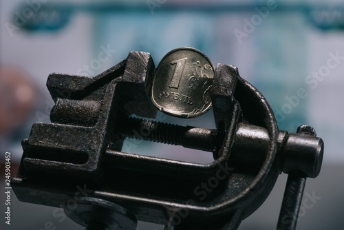 close-up view of iron vise tool with one ruble coin, selective focus Billede på lærred