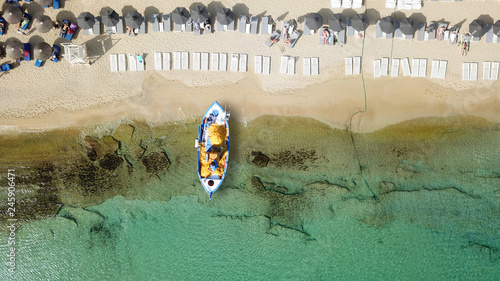 Aerial photo from traditional picturesque fishing boat on turquoise clear sea as Wallpaper Mural