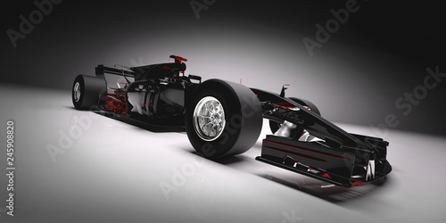 Side of F1 car on light background.