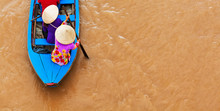 Vietnamese Old Woman On Traditional Boat In Mekong River Delta