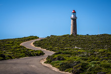 Lighthouse With Red Top And Winding Road At Cape Du Couedic On Kangaroo Island In Australia