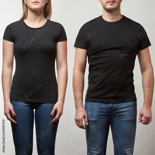 cropped view of young man and woman in black t-shirts with copy space isolated on grey Fototapete