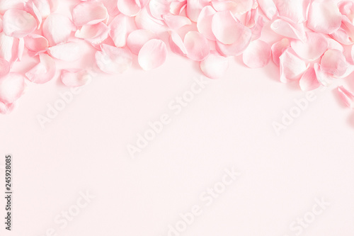 Flowers composition. Rose flower petals on pastel pink background. Valentines day, mothers day, womens day, wedding concept. Flat lay, top view, copy space