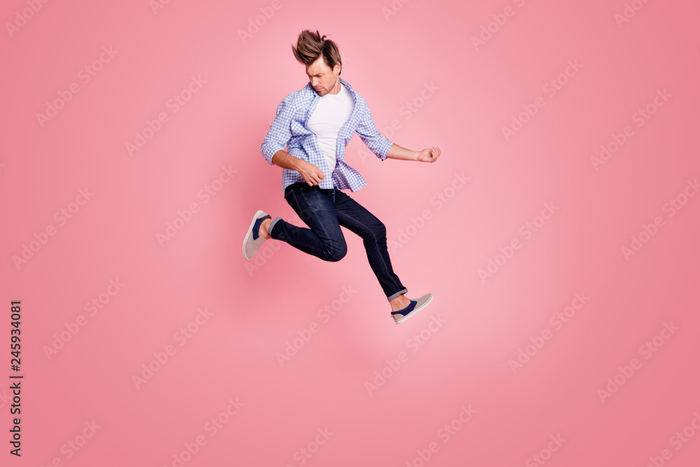 Fototapety, obrazy: Full length body size photo of jumping high crazy he his him macho playing imagine electric guitar in arms hands hair fly wearing casual jeans checkered plaid shirt isolated on rose background