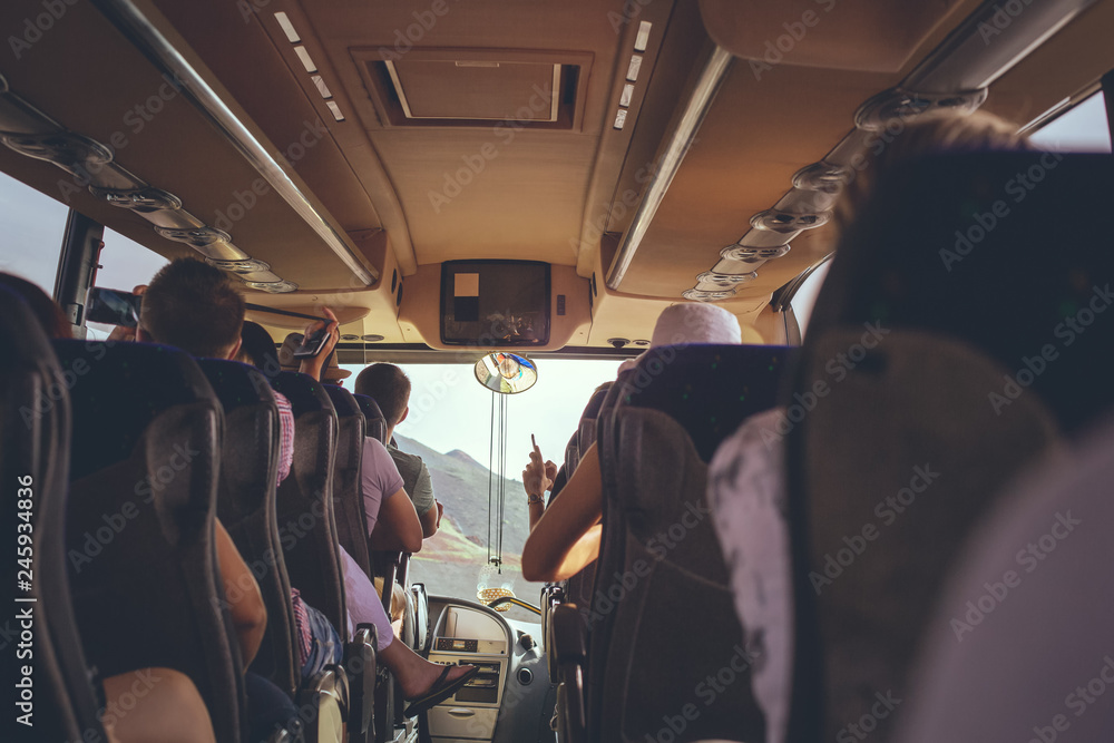 Fototapety, obrazy: The tourist bus interior with people sitting