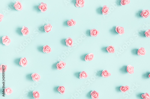 Flowers composition. Pink rose flowers on pastel blue background. Valentines day, mothers day, womens day concept. Flat lay, top view