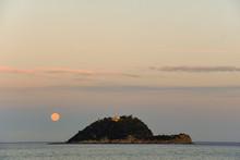 Sea View With An Island At Sunset With Full Moon, Gallinara Island, Alassio, Liguria, Italy