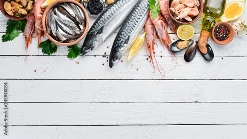 Photo  Seafood on a white wooden background