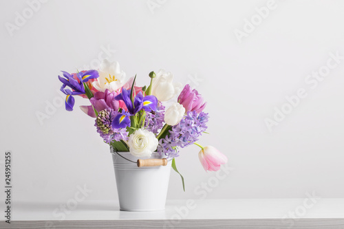 Foto op Plexiglas Lilac spring flowers in bucket on white background
