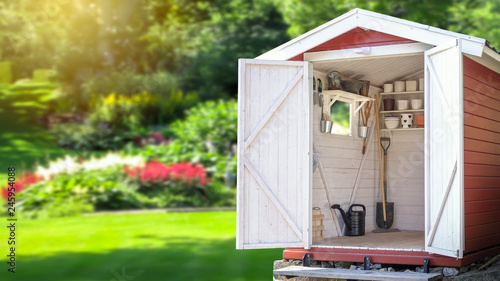 Fotomural Storage shed filled with gardening tools