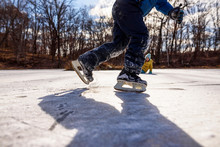 Two Children Ice-skating On A Frozen Pond, United States