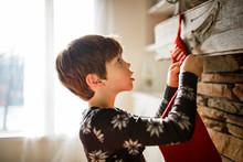 Boy Hanging A Christmas Stocki...