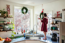 Girl Standing On A Kitchen Wor...
