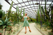 Girl Walking In The Cactus Gar...