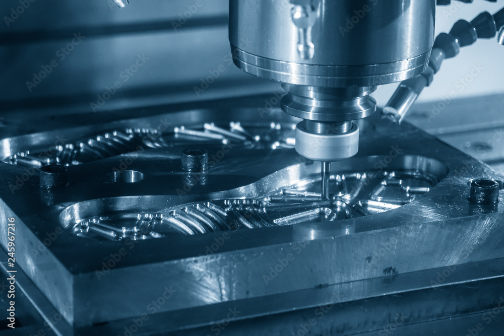 Fototapety, obrazy: The CNC milling machine cutting the mould part with the index-able radius end mill tool in roughing process.The shoe mould manufacturing process.