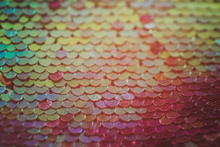 Abstract Sequin Design. Orange Red Fabric Texture. Defocused Background.