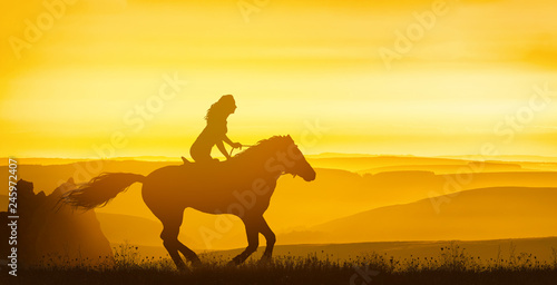Stickers pour portes Equitation Girl rides on the hills under a golden sunset