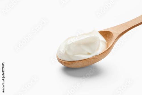 Obraz na plátně  Fresh cream in wooden spoon