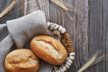 Bread Buns In Basket On Rustic...